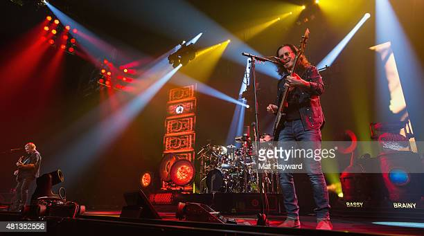 Alex Lifeson Neil Peart and Geddy Lee of Rush performs on stage during the R40 LIVE Tour at KeyArena on July 19 2015 in Seattle Washington