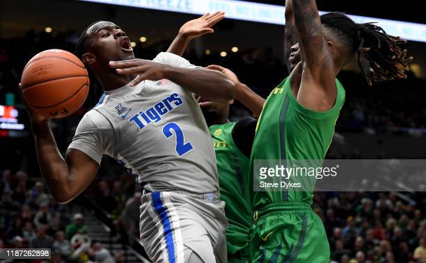 Alex Lomax of the Memphis Tigers drives to the basket on C.J. Walker of the Oregon Ducks during the first half of the game at Moda Center on November...