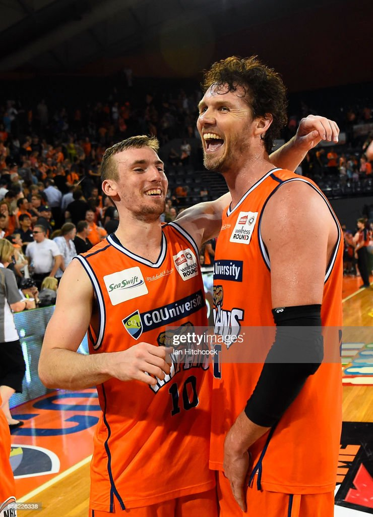 Alex Loughton and Mitch McCarron of the Taipans celebrate after winning the round one NBL match between the Cairns Taipans and the Illawarra Hawks at Cairns Convention Centre on October 6, 2017 in Cairns, Australia.