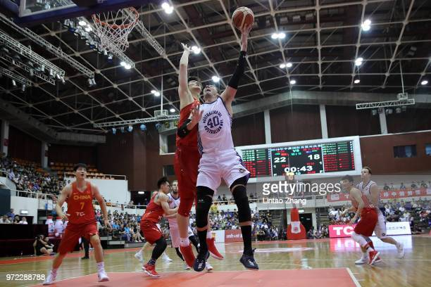 Alex Loughton of Australia drives to the basket against Wang Zhelin of China during the 2018 SinoAustralia Men's Internationl Basketball Challenge...