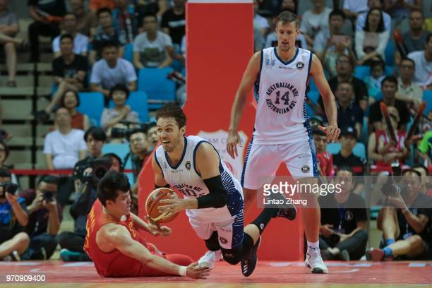 Alex Loughton of Australian in action with Zhao Tailong during the 2018 SinoAustralian Men's Internationl Basketball Challenge match between the...