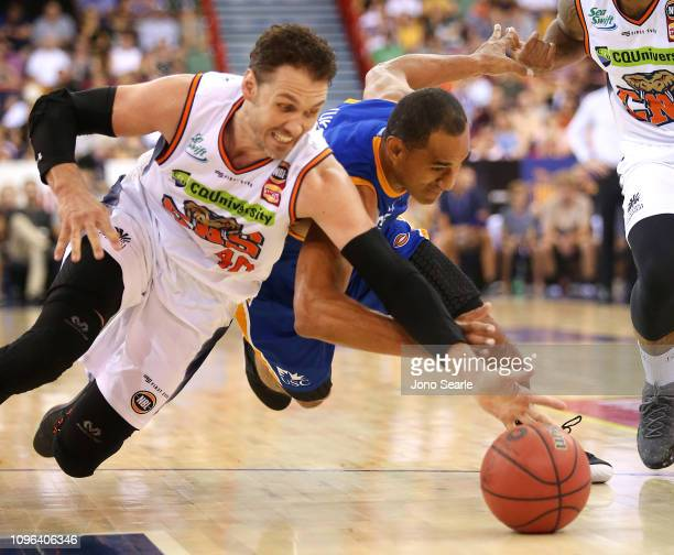 Alex Loughton of Cairns and Mika Vukona compete for the ball during the round 14 NBL match between the Brisbane Bullets and the Cairns Taipans at the...