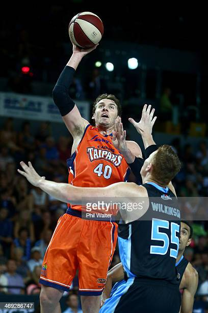 Alex Loughton of the Breakers shoots over the top of Gary Wilkinson of the Breakers during the round 18 NBL match between the New Zealand Breakers...