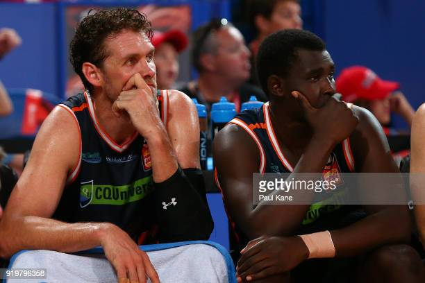Alex Loughton of the Taipans and Kuany Kuany of the Taipans look on from the bench during the round 19 NBL match between the Perth Wildcats and the...