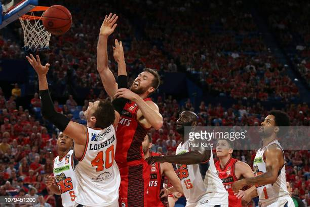 Alex Loughton of the Taipans and Nicholas Kay of the Wildcats contest for a rebound during the round eight NBL match between the Perth Wildcats and...