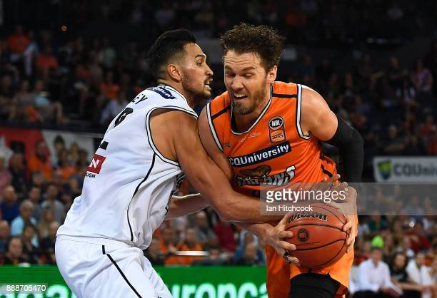 Alex Loughton of the Taipans atempts to drive to the basket past Tai Wesley of Melbourne United during the round nine NBL match between the Cairns...