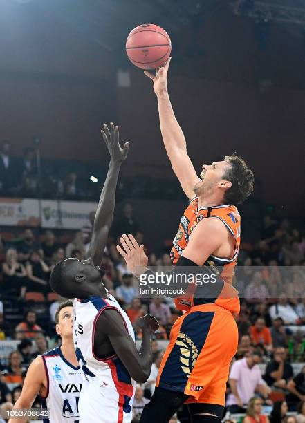 Alex Loughton of the Taipans attempts a jump shot during the round three NBL match between the Cairns Taipans and the Adelaide 36ers at Cairns...