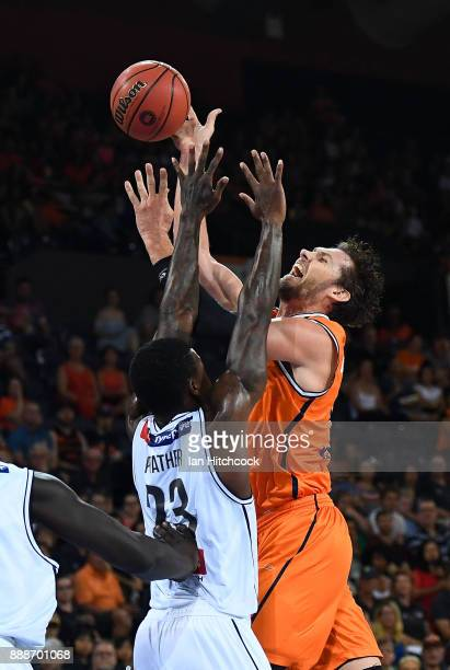 Alex Loughton of the Taipans attempts a lay up against Casey Prather of Melbourne United during the round nine NBL match between the Cairns Taipans...