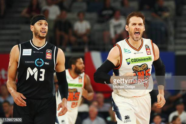 Alex Loughton of the Taipans celebrates a basket against Josh Boone of United during the round 18 NBL match between Melbourne United and the Cairns...