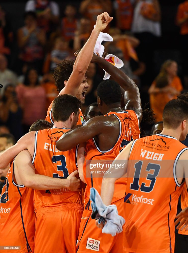 Alex Loughton of the Taipans celebrates with teammates after scoring the winning basket during the round one NBL match between the Cairns Taipans and the Illawarra Hawks at Cairns Convention Centre on October 6, 2017 in Cairns, Australia.