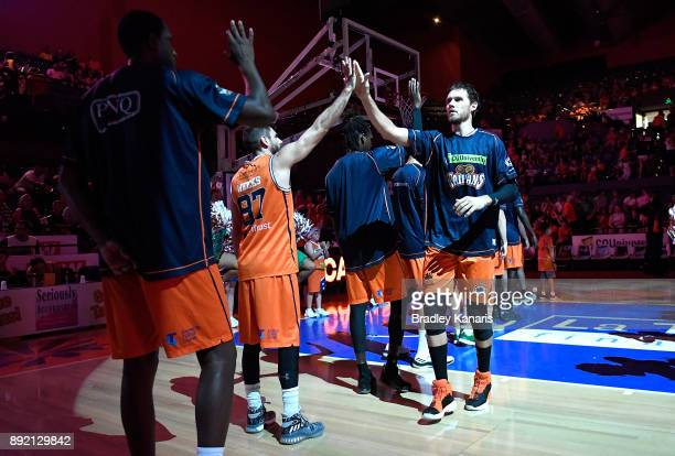Alex Loughton of the Taipans comes out to greet his team mates before the round 10 NBL match between the Cairns Taipans and the Brisbane Bullets at...