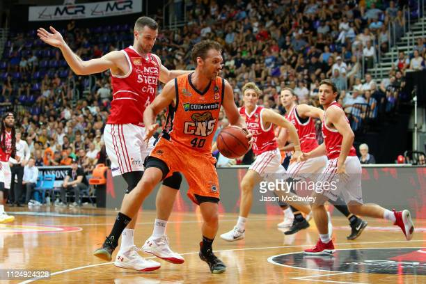 Alex Loughton of the Taipans dribbles the ball during the round 15 NBL match between the Illawarra Hawks and the Cairns Taipans at AIS on January 26...