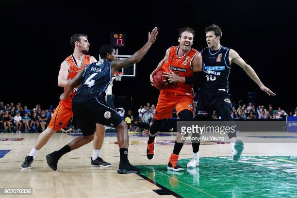 Alex Loughton of the Taipans drives against Tom Abercrombie of the Breakers during the round 13 NBL match between the New Zealand Breakers and the...