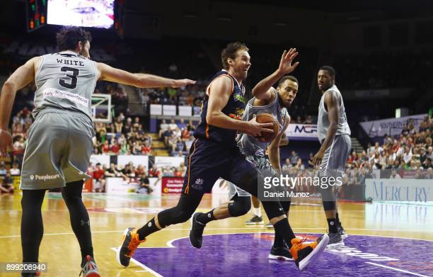 Alex Loughton of the Taipans evades the Hawks defense during the round 12 NBL match between the Illawarra Hawks and the Cairns Taipans at Wollongong...