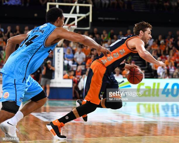 Alex Loughton of the Taipans gets away from Mika Vukona of the Breakers during the round 15 NBL match between the Cairns Taipans and the New Zealand...