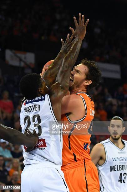 Alex Loughton of the Taipans is blocked by Casey Prather of Melbourne United during the round nine NBL match between the Cairns Taipans and Melbourne...