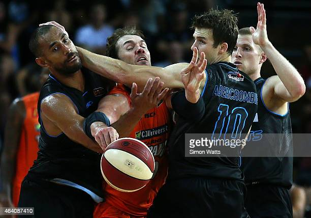 Alex Loughton of the Taipans is fould by Mika Vukona and Thomas Abercrombie of the Breakers during the round 22 NBL match between New Zealand...