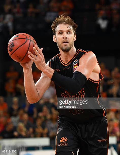 Alex Loughton of the Taipans looks to pass the ball during the round eight NBL match between the Cairns Taipans and the Sydney Kings at Cairns...