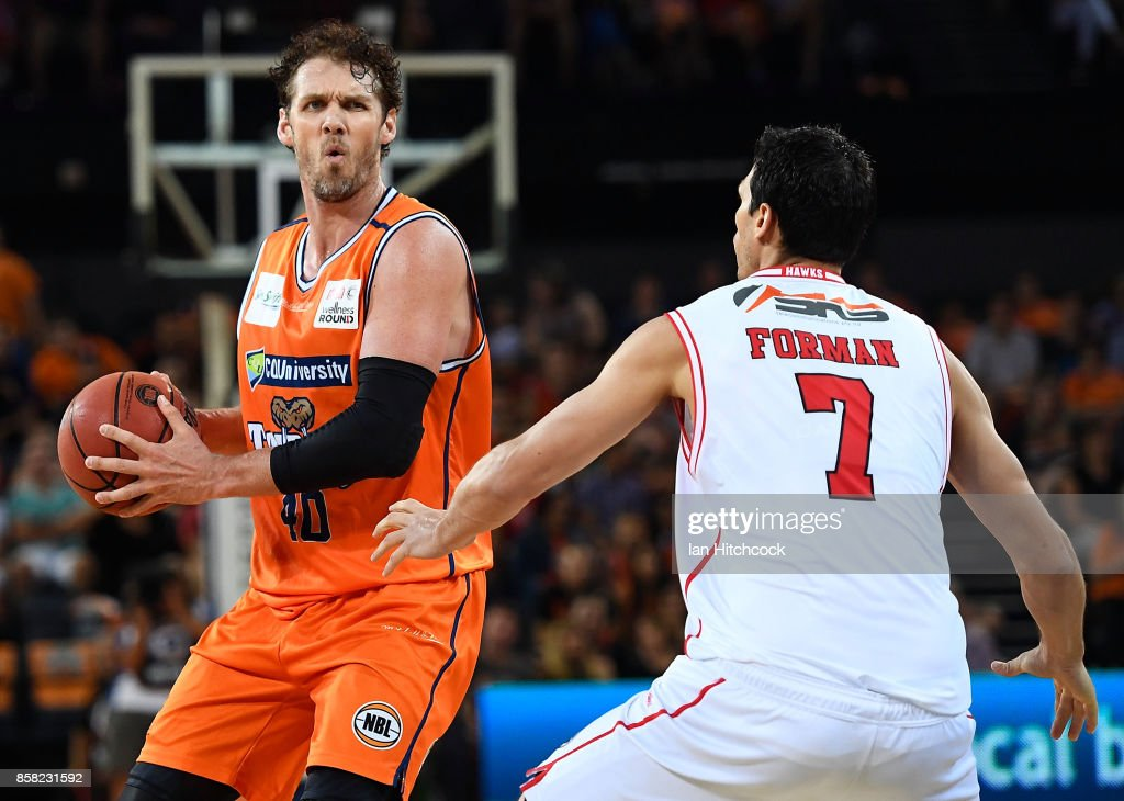 Alex Loughton of the Taipans looks to pass the ball past Oscar Forman of the Hawks during the round one NBL match between the Cairns Taipans and the Illawarra Hawks at Cairns Convention Centre on October 6, 2017 in Cairns, Australia.