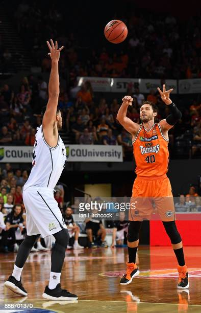 Alex Loughton of the Taipans passes the ball during the round nine NBL match between the Cairns Taipans and Melbourne United at Cairns Convention...