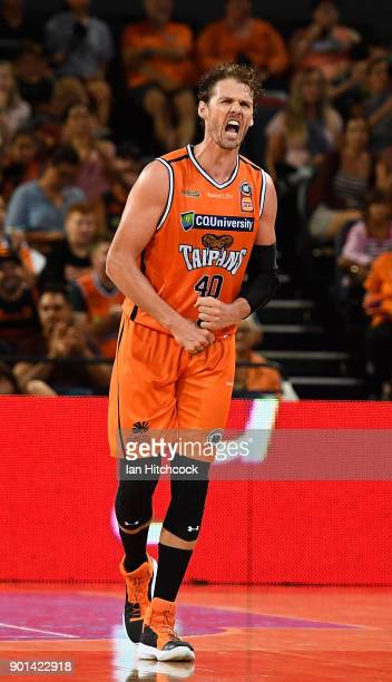 Alex Loughton of the Taipans reacts after scoring a three point shot during the round 13 NBL match between the Cairns Taipans and the Brisbane...