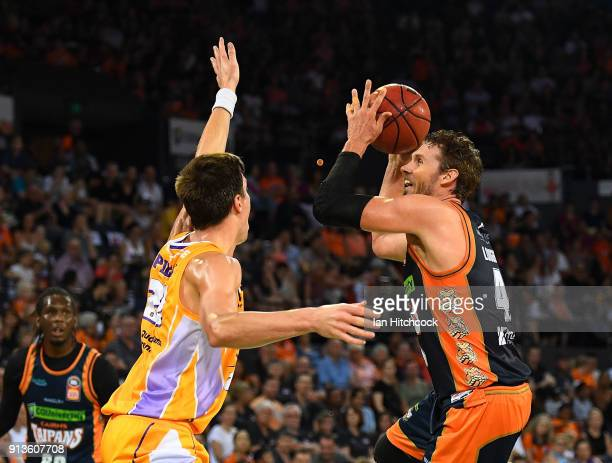 Alex Loughton of the Taipans takes a jump shot over Dane Pineau of the Kings during the round 17 NBL match between the Cairns Taipans and the Sydney...