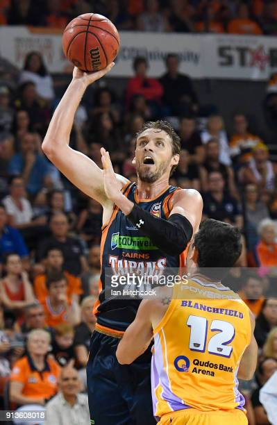 Alex Loughton of the Taipans takes a jump shot over Todd Blanchfield of the Kings during the round 17 NBL match between the Cairns Taipans and the...