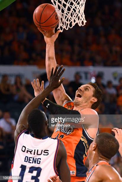 Alex Loughton of the Taipans takes a shot during the round three NBL match between the Cairns Taipans and the Adelaide 36ers at Cairns Convention...