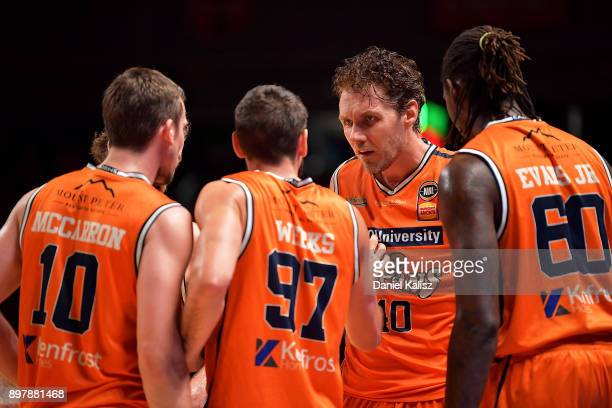 Alex Loughton of the Taipans talks to his team mates during the round 11 NBL match between the Adelaide 36ers and the Cairns Taipans at Titanium...