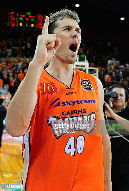 Alex Loughton of the the Taipans celebrates after winning game two of the NBL Grand Final series between the Cairns Taipans and the New Zealand...
