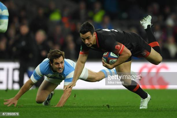 Alex Lozowski of England is tackled by Nicolas Sanchez of Argentina during the England v Argentina Old Mutual Wealth Series match at Twickenham...