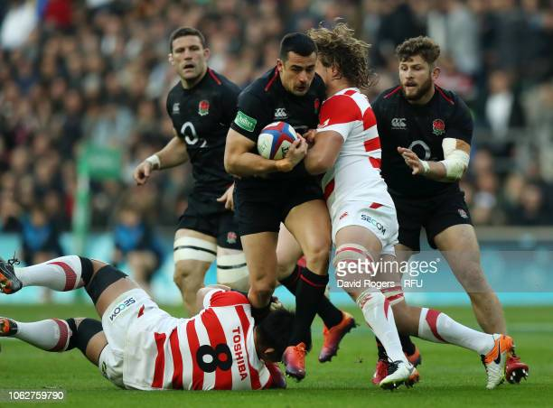 Alex Lozowski of England is tackled by Wimpie Van Der Walt of Japan during the Quilter International match between England and Japan at Twickenham...