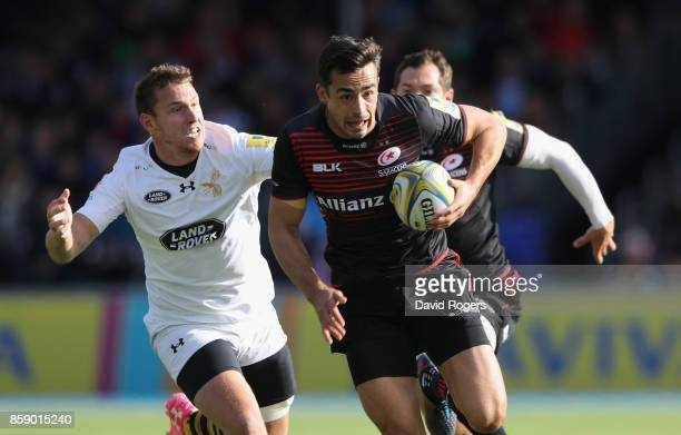 Alex Lozowski of Saracens breaks away from Brendon Macken during the Aviva Premiership match between Saracens and Wasps at Allianz Park on October 8...