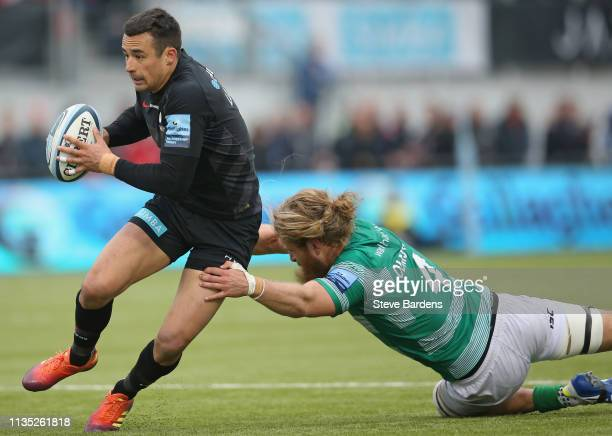 Alex Lozowski of Saracens breaks the tackle of Evan Olmstead of Newcastle Falcons during the Gallagher Premiership Rugby match between Saracens and...