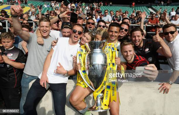 Alex Lozowski of Saracens celebrates with the crowd after their victory during the Aviva Premiership Final between Exeter Chiefs and Saracens at...