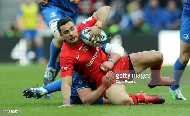 Alex Lozowski of Saracens is tackled during the Champions Cup Final match between Saracens and Leinster at St. James Park on May 11, 2019 in...