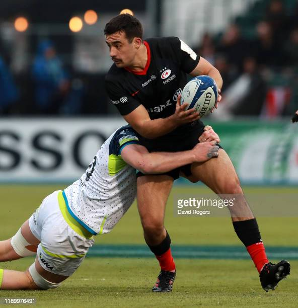 Alex Lozowski of Saracens is tackled during the Heineken Champions Cup Round 2 match between Saracens and Ospreys at Allianz Park on November 23 2019...