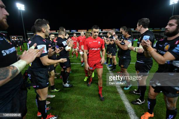 Alex Lozowski of Saracens leads the team off the field dejected following their side's loss during the Gallagher Premiership Rugby match between...