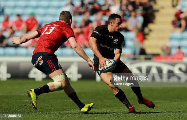 Alex Lozowski of Saracens looks to pass the ball during the Champions Cup Semi Final match between Saracens and Munster at the Ricoh Arena on April...