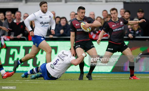 Alex Lozowski of Saracens tackled by Elliott Stooke of Bath during the Aviva Premiership match between Saracens and Bath Rugby at Allianz Park on...