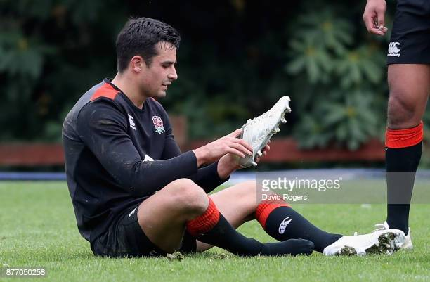 Alex Lozowski puts on his boots during the England training session held at Pennyhill Park on November 21 2017 in Bagshot England