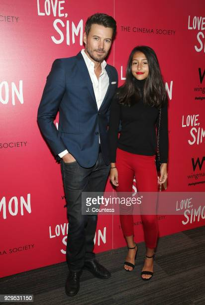 Alex Lundqvist and Karolina pose for a photo at the screening of Love Simon hosted by 20th Century Fox Wingman at The Landmark at 57 West on March 8...