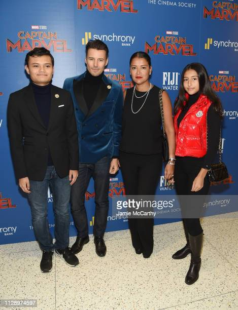 Alex Lundqvist and Keytt Lundqvist pose with their children at the 'Captain Marvel' screening at Henry R Luce Auditorium at Brookfield Place on March...