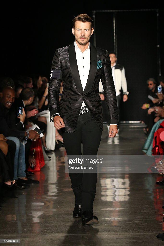 Alex Lundqvist walks the runway at the 2015 amfAR Inspiration Gala New York at Spring Studios on June 16, 2015 in New York City.