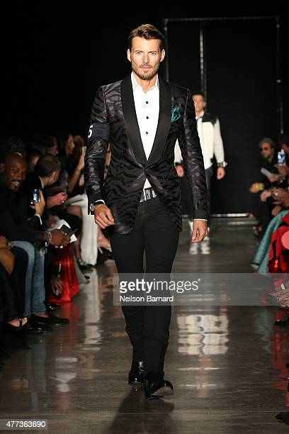 Alex Lundqvist walks the runway at the 2015 amfAR Inspiration Gala New York at Spring Studios on June 16 2015 in New York City