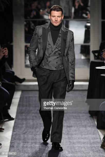 Alex Lundqvist walks the runway wearing Joseph Abboud Fall 2018 at Hotel Wolcott Ballroom on February 6 2018 in New York City