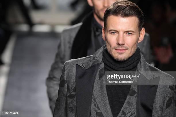 Alex Lundqvist walks the runway wearing Joseph Abboud Fall 2018 at Hotel Wolcott Ballroom on February 6 2018 in New York City