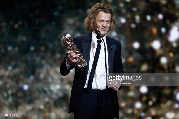 Alex Lutz speaks on stage after receiving the Cesar award for best actor during Cesar Film Awards 2019 at Salle Pleyel on February 22 2019 in Paris...