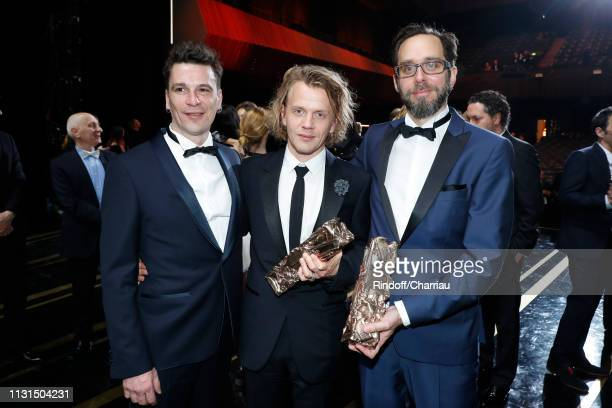 Alex Lutz winner of the award for Best Actor for Guy standing between Vincent Blanchard and Romain Greffe winners of the award for Best Original...