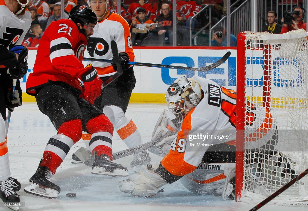 Alex Lyon #49 of the Philadelphia Flyers defends the net in the second period against Kyle Palmieri #21 of the New Jersey Devils on February 1, 2018 at Prudential Center in Newark, New Jersey.